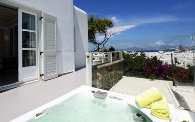 Private Jacuzzi spa with a view of the sea & Mykonos town in the luxury Semeli Suite Panoramic View