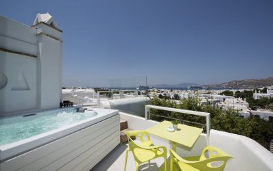 Jacuzzi on the outdoor private veranda of the Executive Suite sea view at Semeli Hotel in Mykonos