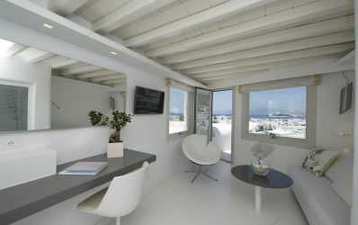 Luxury living room with desk, chairs & sofa in Semeli Hotel Twin Jacuzzi sea view Suite in Mykonos