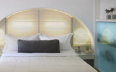 Bed in the stylish design luxury Superior Double Rooms at the Semeli Best Hotel in Mykonos