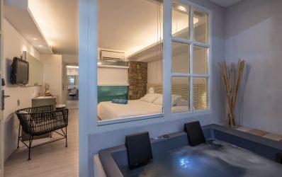 Indoor jacuzzi by the luxury bedroom in the Two Bedroom Spa in Semeli Hotel in Mykonos.