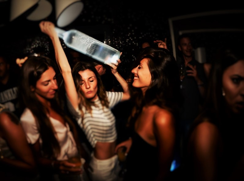 Young women dancing and having fun at a bar in Mykonos Town which is famous for its nightlife.