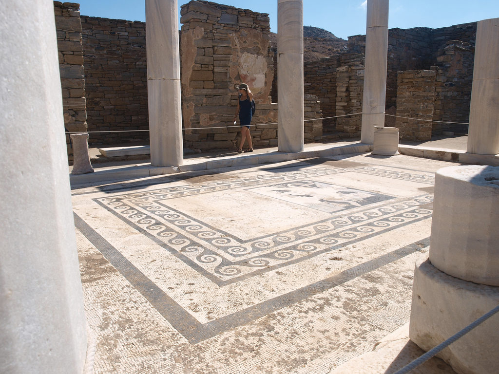 The main section of an ancient temple in Delos. Mosaic on the floor and impressive columns.