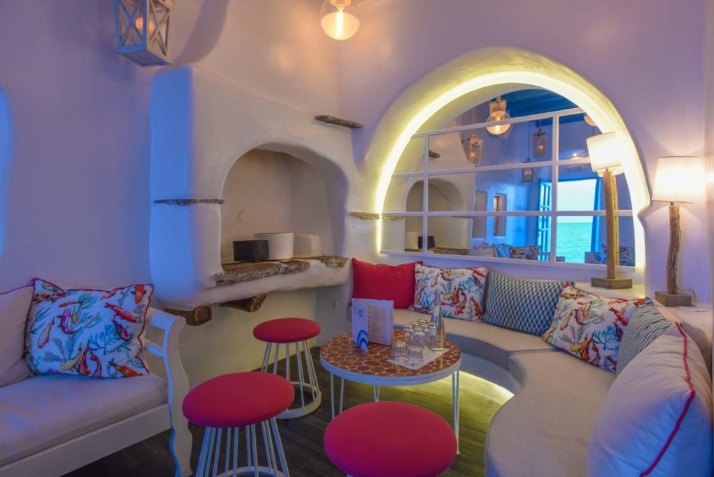 Stylish built-in sofa and stools at the Bao's, the cocktail bar in Mykonos Town.