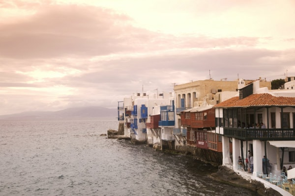 Afternoon at Little Venice in Mykonos island. Traditional houses and crystal clear sea.