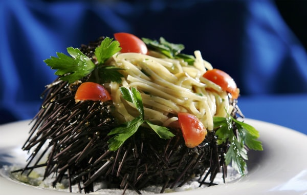 Delicious dish with sea urchin and vegetables at the gourmet restaurant of Semeli Hotel in Mykonos.