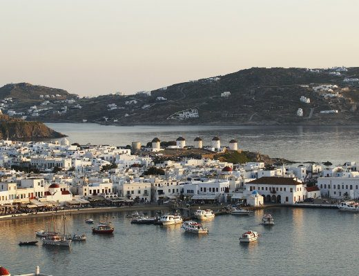View of the famous windmills of the island of Mykonos and of the traditional houses of the island.