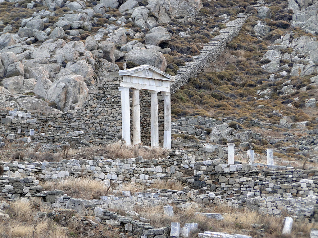 Visitors in Delos island can admire many archaeological sights. The entrance of an ancient temple.