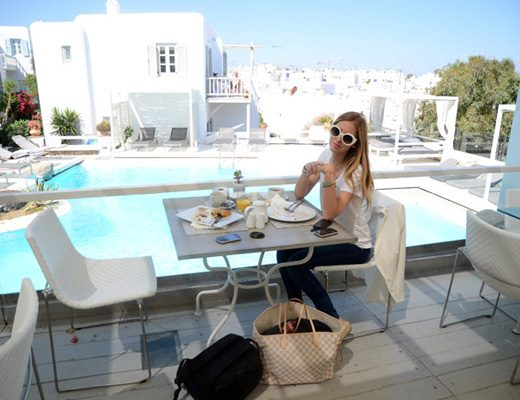 Fashion blogger Chiarra Ferragni at the restaurant of Semeli Best Hotel in Mykonos.
