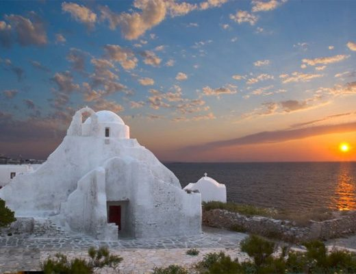 A historic church in Mykonos at sunset. Beautiful view of the sea and the sky.