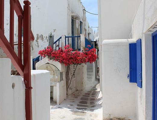 Beautiful path and traditional houses at the island of Mykonos, where Semeli Best Hotel is located.