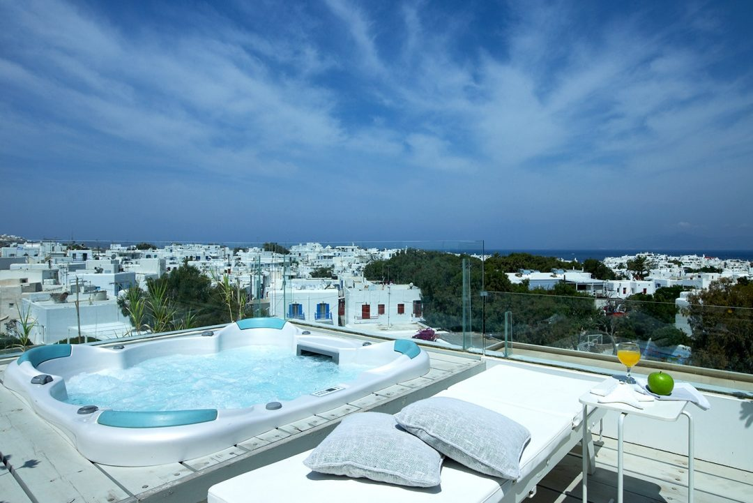 Outdoor jacuzzi at Semeli Luxury Hotel in Mykonos overlooking the Mykonos Town.