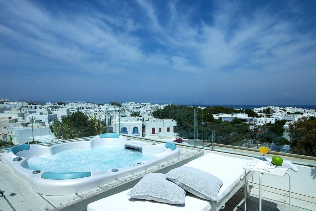 Outdoor jacuzzi at Semeli Luxury Hotel in Mykonos overlooking the Mykonos Town.