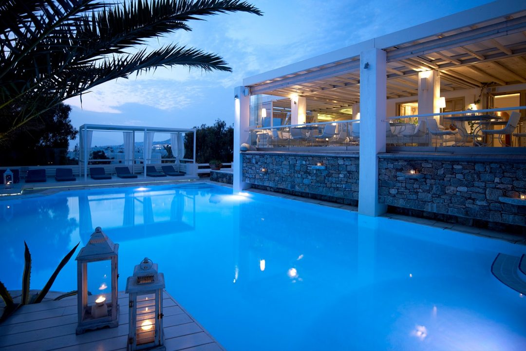 The restaurant of Semeli Luxury Hotel in Mykonos overlooking the crystal clear pool.