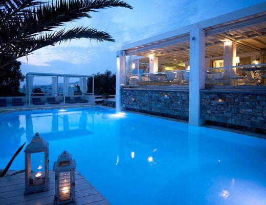 The restaurant of Semeli Luxury Hotel in Mykonos overlooking the crystal clear pool.