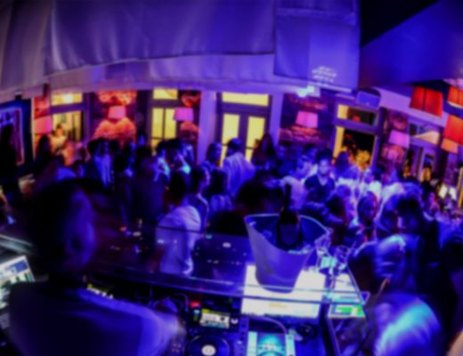 Busy nightlife in a bar in Mykonos Town, which is also the home of the Semeli Best Luxury Hotel