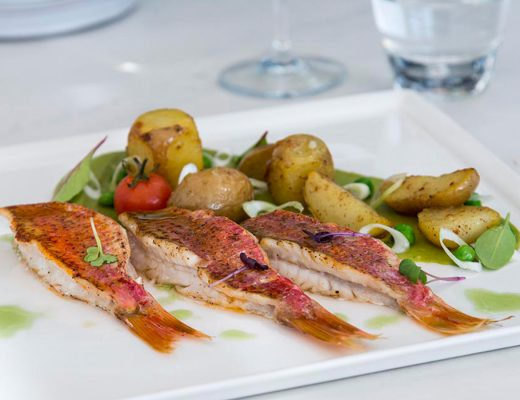 Fresh fish dish with salad & potatoes served at Thioni Restaurant in Semeli Hotel Best Hotel Mykonos