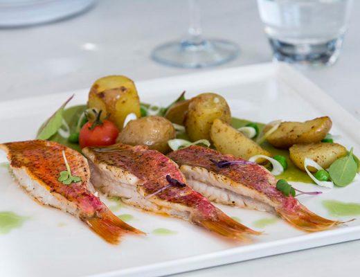 Fresh fish dish with salad & potatoes served at Thioni Restaurant in Semeli Hotel Best Hotel Mykonos