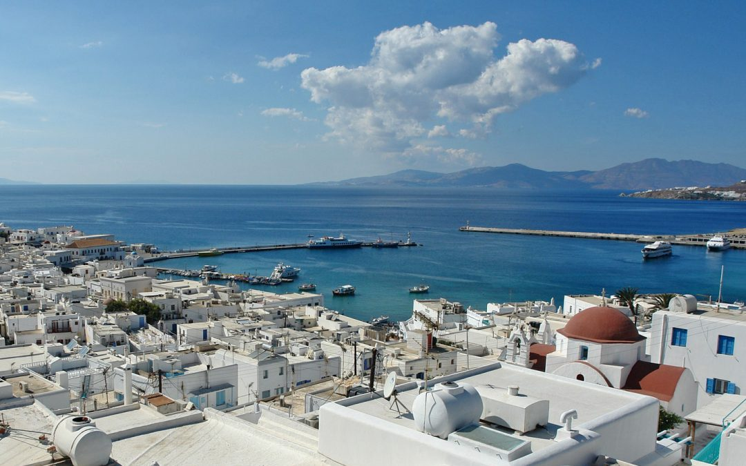 Panoramic view of the port of Mykonos and of Mykonos town as seen from Semeli Best Hotel.