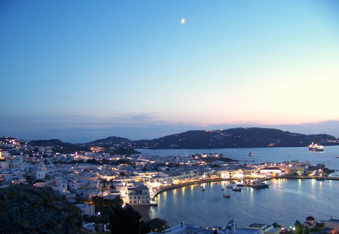 Panoramic view of the port of Mykonos and of the Mykonos Town at dusk.