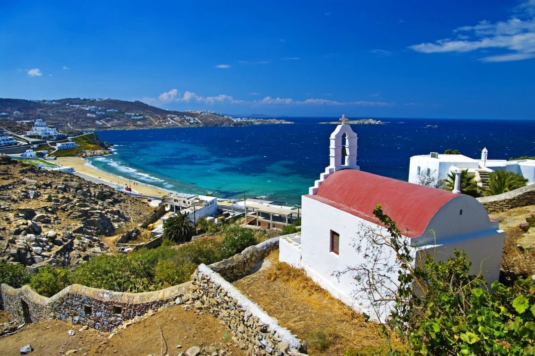 A chapel on a hill overlooking the sea in Mykonos, where Semeli Best Hotel is located.