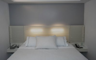 Lights behind the double bed at the bedroom of the Two Bedroom Spa Room in Mykonos.