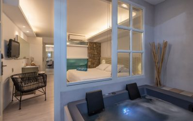 Indoor jacuzzi by the luxury bedroom in the Two Bedroom Spa in Semeli Hotel in Mykonos.